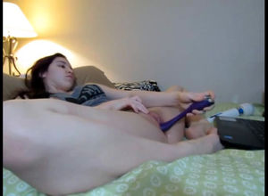 Lush young woman dildoing cunt while..